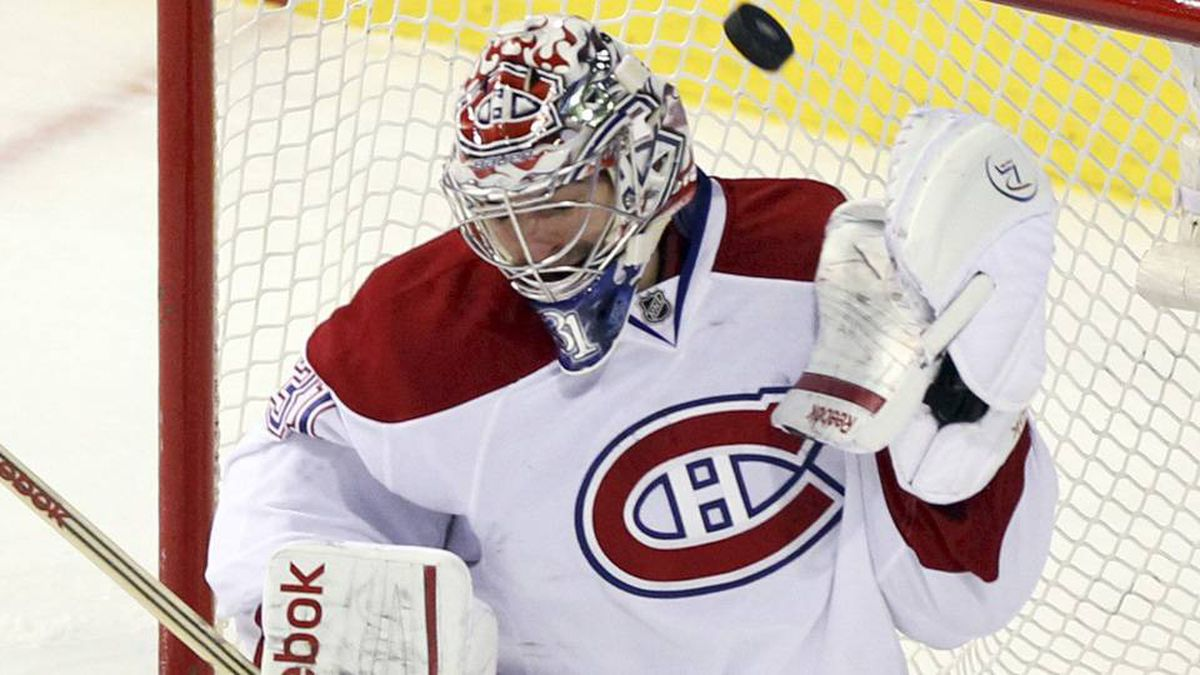 Montreal Canadiens' goalie Carey Price makes a save against Ottawa Senators during third period NHL hockey action in Montreal, March 14, 2012.