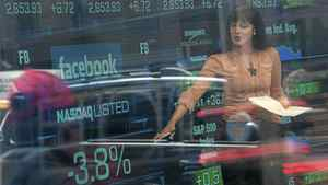A television reporter talks about the Facebook stock at the Nasdaq Stock Market in New York.