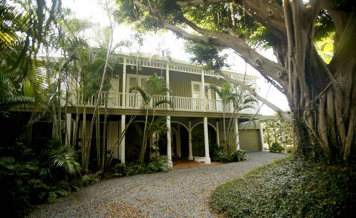 A large banyon tree sits in the front yard of Bernard Madoff's Palm Beach, Fla. home Tuesday, Sept. 8, 2009. The house will be sold at auction.