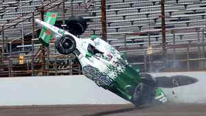 Simona De Silvestro of Switzerland crashes in the third turn during practice for the Indianapolis 500 on May 19, 2011. She suffered second-degree burns to her right hand and less serious ones to her left.
