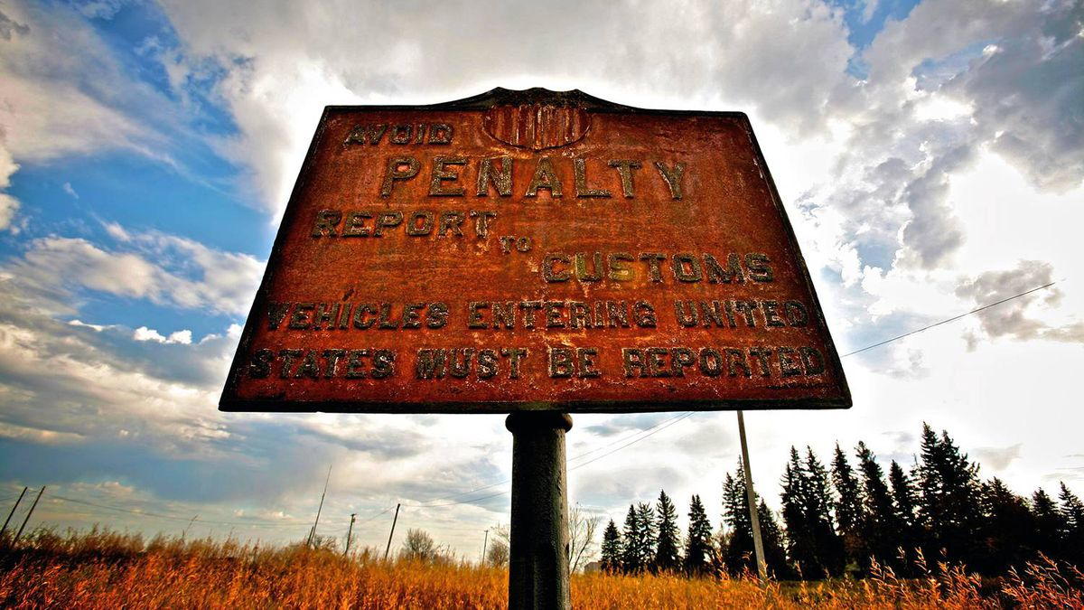 Just outside Emerson, Man., an old rusty sign in a field on the Minnesota side of the United States/Canada border warns of penalties if a person enters the United States without reporting to Customs.