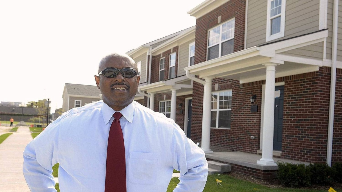 Executive Director Eugene Jones standing in front of a new units at the new Cornerstone Estates. Detroit, Mi. September, 27, 2011.