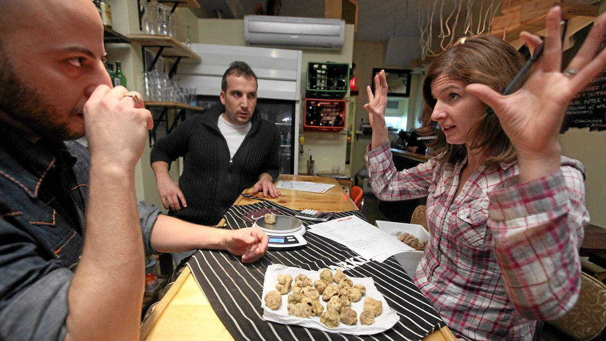 From left, Michael Sangregorio, managing owner of Local Kitchen and Wine Bar in Toronto, and chef/owner Fabio Bondi examine Wanda Srdoc's freshly delivered truffles from Croatia