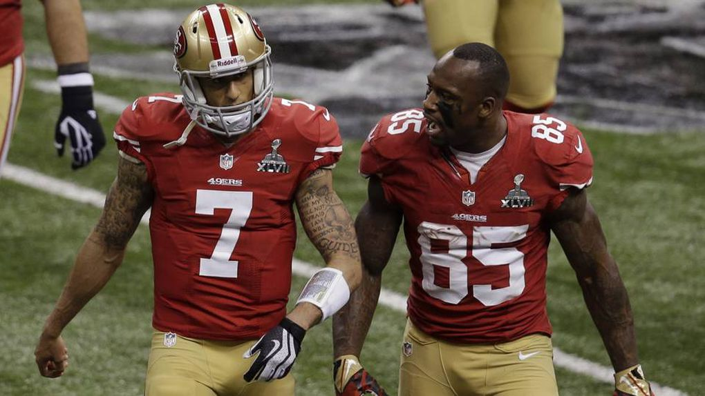 ... Vernon Davis (85) and quarterback Colin Kaepernick (7) talk between  plays against the Baltimore Ravens during the first half of the NFL Super  Bowl XLVII ... 739faff96