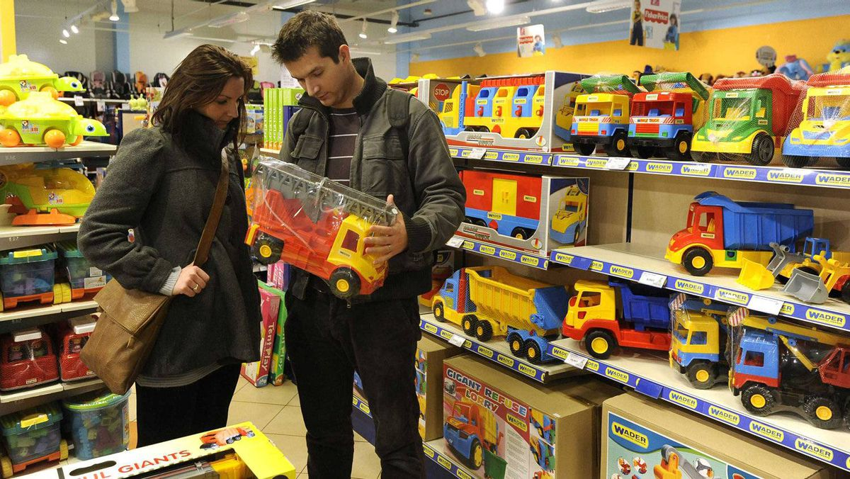 Mortgage broker Nada Helikova, 28, and her husband Milos Helik, 29, who do not have children, look at a toy truck inside the Alltoys toy shop in Trencin, Slovakia.