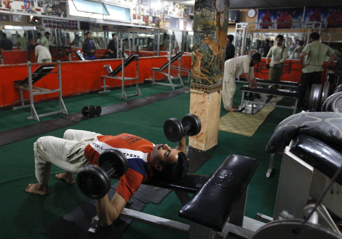 A man exercises in a gym in Abbottabad, Pakistan. Osama bin Laden was killed almost a year ago, on May 2, 2011, by a United States special operations military unit in a raid on his compound in Abbottabad.