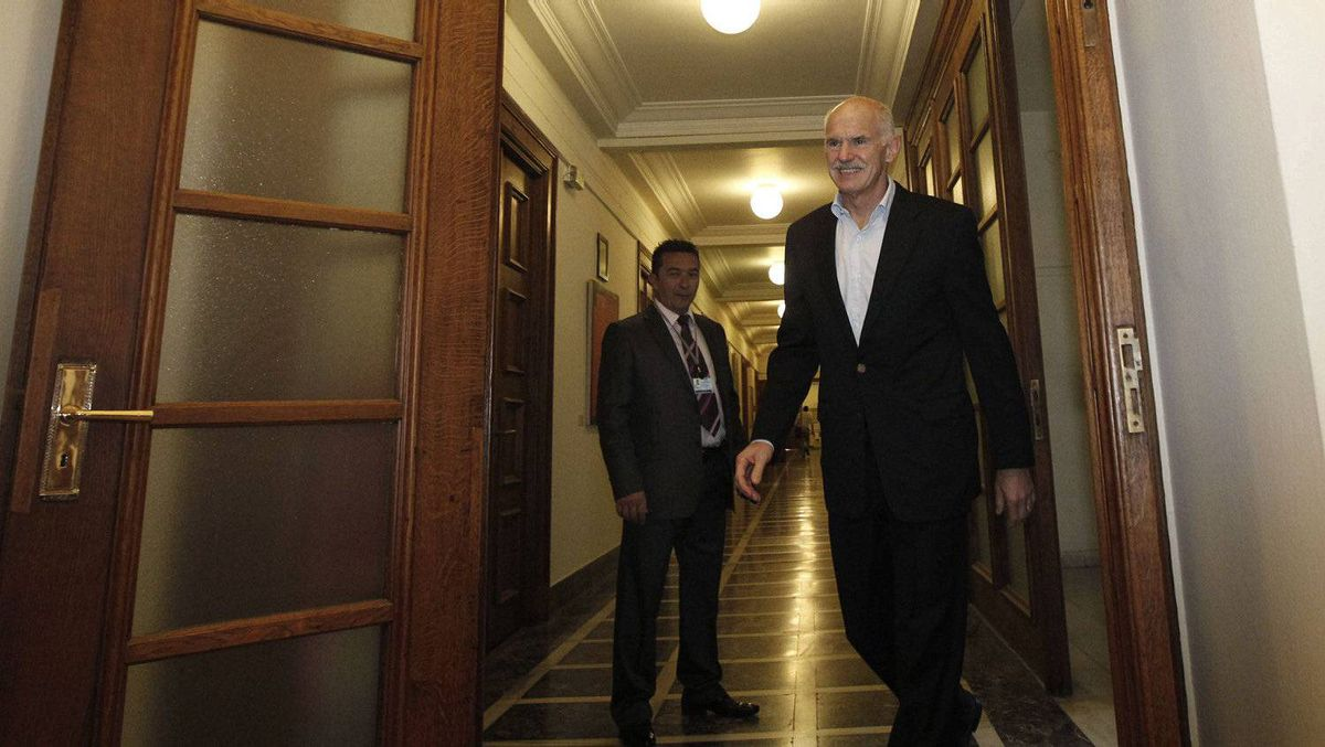 Greek Prime Minister George Papandreou arrives at a cabinet meeting in the Greek parliament in Athens on Sept. 29, 2011. International auditors return to Athens on Thursday to deliver a verdict on whether Greece's tougher austerity measures qualify for aid to avert a default that would plunge the country into bankruptcy.