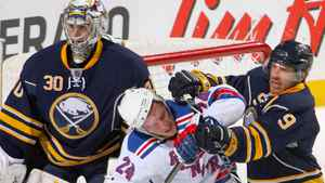 Ryan Callahan #24 of the New York Rangers is cross-checked in front of Ryan Miller #30 of the Buffalo Sabres by Derek Roy #9 at HSBC Arena on April 6, 2010 in Buffalo, New York. Roy was called for a penalty on the play. (Photo by Rick Stewart/Getty Images)