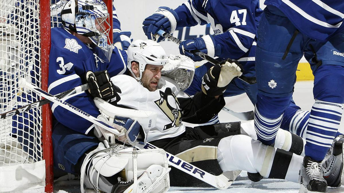 Darryl Boyce #47 of the Toronto Maple Leafs pushes Mike Rupp #17 of the Pittsburgh Penguins into James Reimer #34 of the Toronto Maple Leafs during game action at the Air Canada Centre February 26, 2011 in Toronto, Ontario, Canada. The Penguins won 6-5 in a shootout. (Photo by Abelimages/Getty Images)