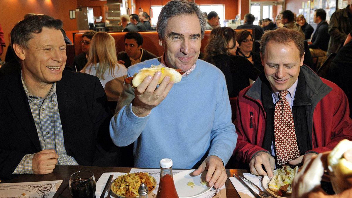 Liberal Leader Michael Ignatieff has a hot dog for lunch with Winnipeg candidates Terry Duguid and Kevin Kevin Lamoureux at Kelekis restaurant on March 31, 2011.