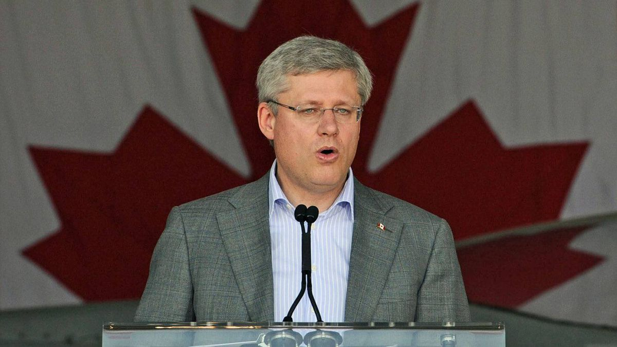 Prime Minister Stephen Harper delivers a speech to Canadian troops at the Trapani air-force base in Italy on Sept. 1, 2011.