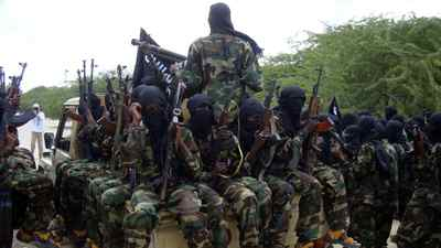 In this 2010 photo, al-Shabab fighters conduct a military exercise in northern Mogadishu's Suqaholaha neighbourhood.