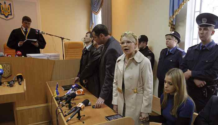 Ukrainian ex-prime minister Yulia Tymoshenko (2nd R front) holds the hand of her daughter Yevgenia as she speaks during a session at the Pecherskiy district court in front of judge Rodion Kireyev (L) in Kiev October 11, 2011. The European Commission said on Tuesday it was deeply disappointed by the sentencing of Ukraine's former prime minister Yulia Tymoshenko to seven years in prison and said it could have profound implications for ties with the EU.