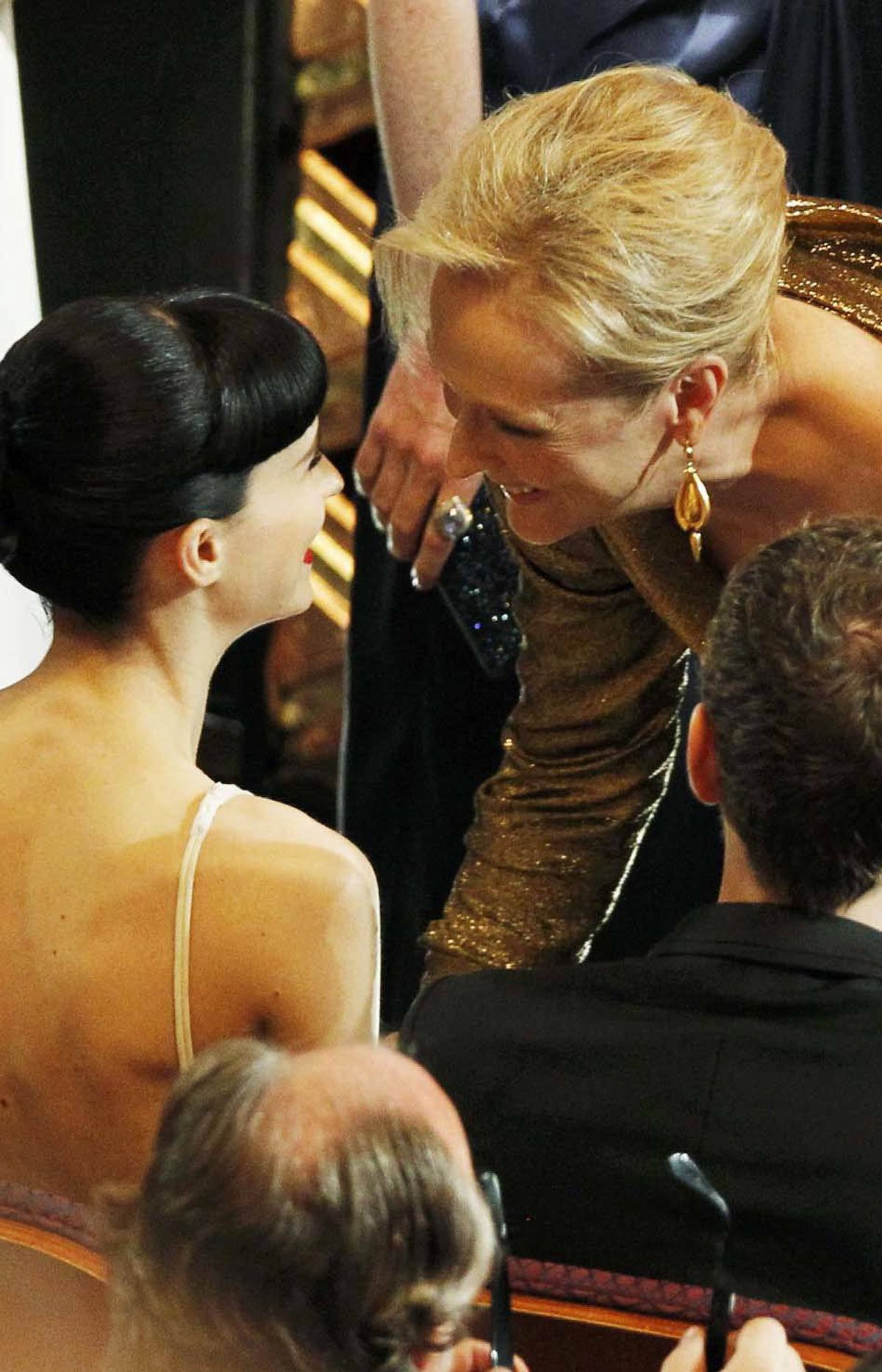 Best actress nominees Meryl Streep (right) and Rooney Mara threaten to kill each other at the Academy Awards on Sunday.