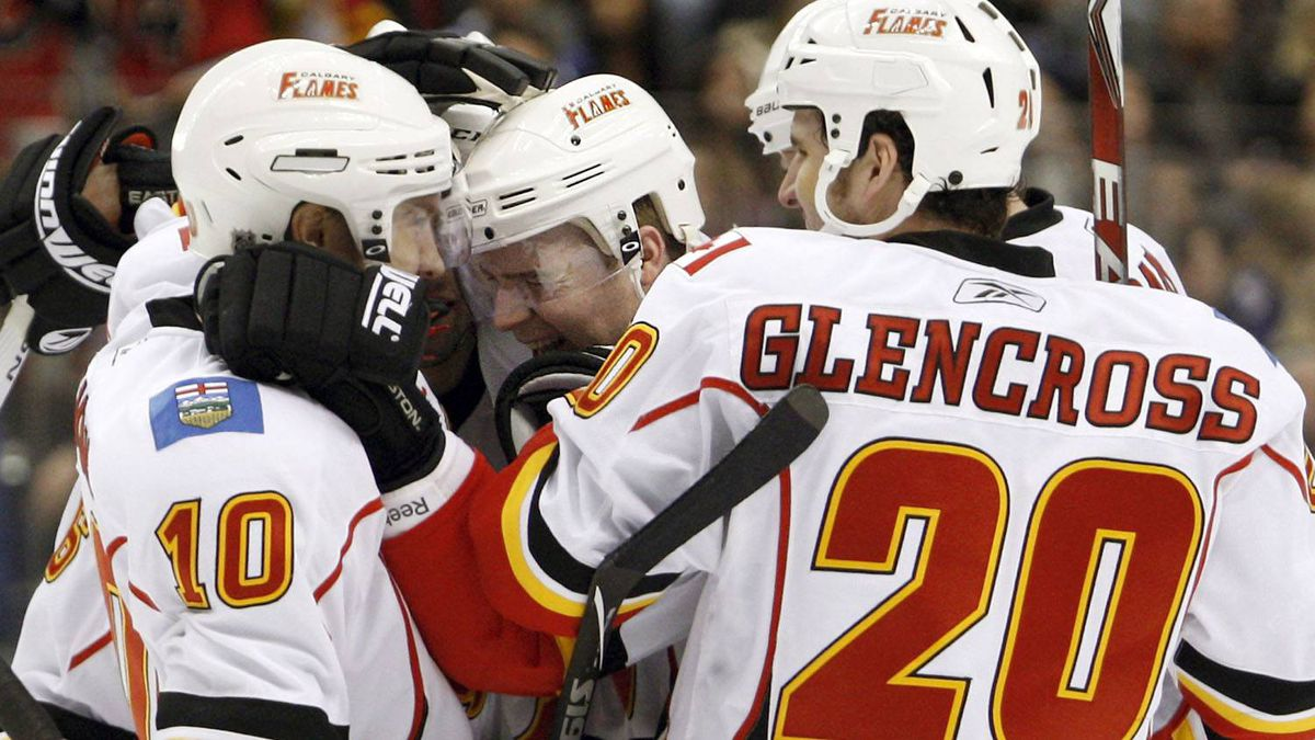 Calgary Flames forward Matt Stajan (C) celebrates his goal against the Toronto Maple Leafs with teammates Niklas Hagman (L) and Curtis Glencross (R) during the third period of their NHL hockey game in Toronto January 15, 2011. REUTERS/Mike Cassese
