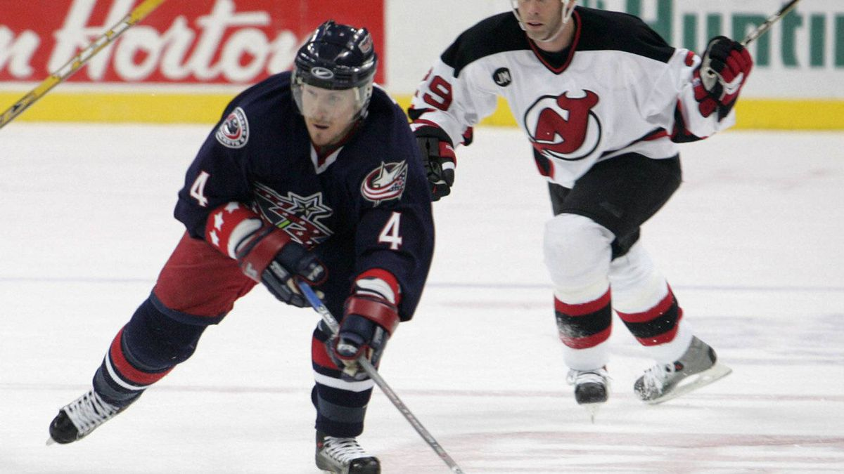 Columbus Blue Jackets' Bryan Berard, left, skates up the ice as the New Jersy Devils' Grant Marshall chases in the second period on Sunday, Dec. 11, 2005, at Nationwide Arena in Columbus, Ohio. Berard was picked 1st overall in 1995 by the Ottawa Senators, who then drafted Chris Phillips 1st overall in 1996.