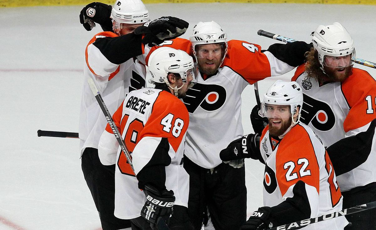 Kimmo Timonen #44 of the Philadelphia Flyers celebrates with teammates after scoring a goal in the second period against the Chicago Blackhawks in Game Five of the 2010 NHL Stanley Cup Final at the United Center on June 6, 2010 in Chicago, Illinois. (Photo by Jim McIsaac/Getty Images)
