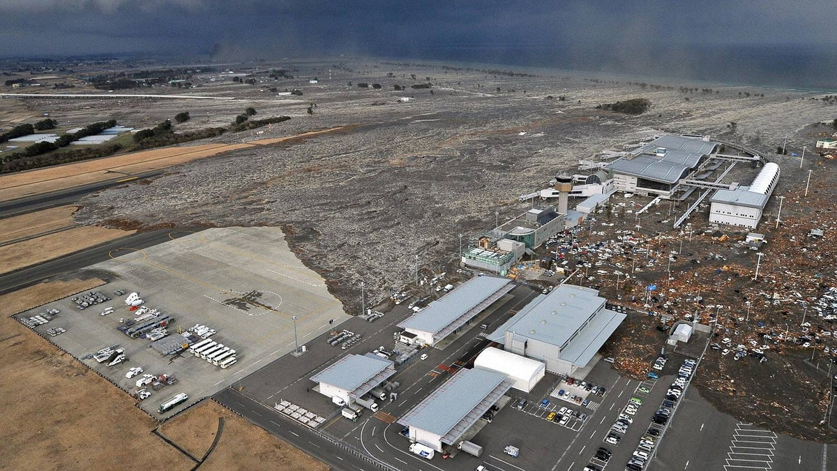 Sendai Airport is swept by a tsunami after an earthquake, in northeastern Japan