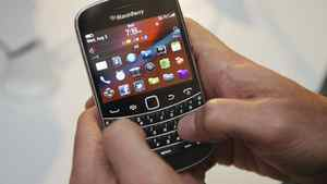 A person uses the new Blackberry Bold 9900 at a release party to promote the BlackBerry OS 7 devices in Toronto Aug. 3, 2011.