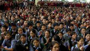 Exiled Tibetans varying in ages from the very young to very old gathered en masse for the ceremony.