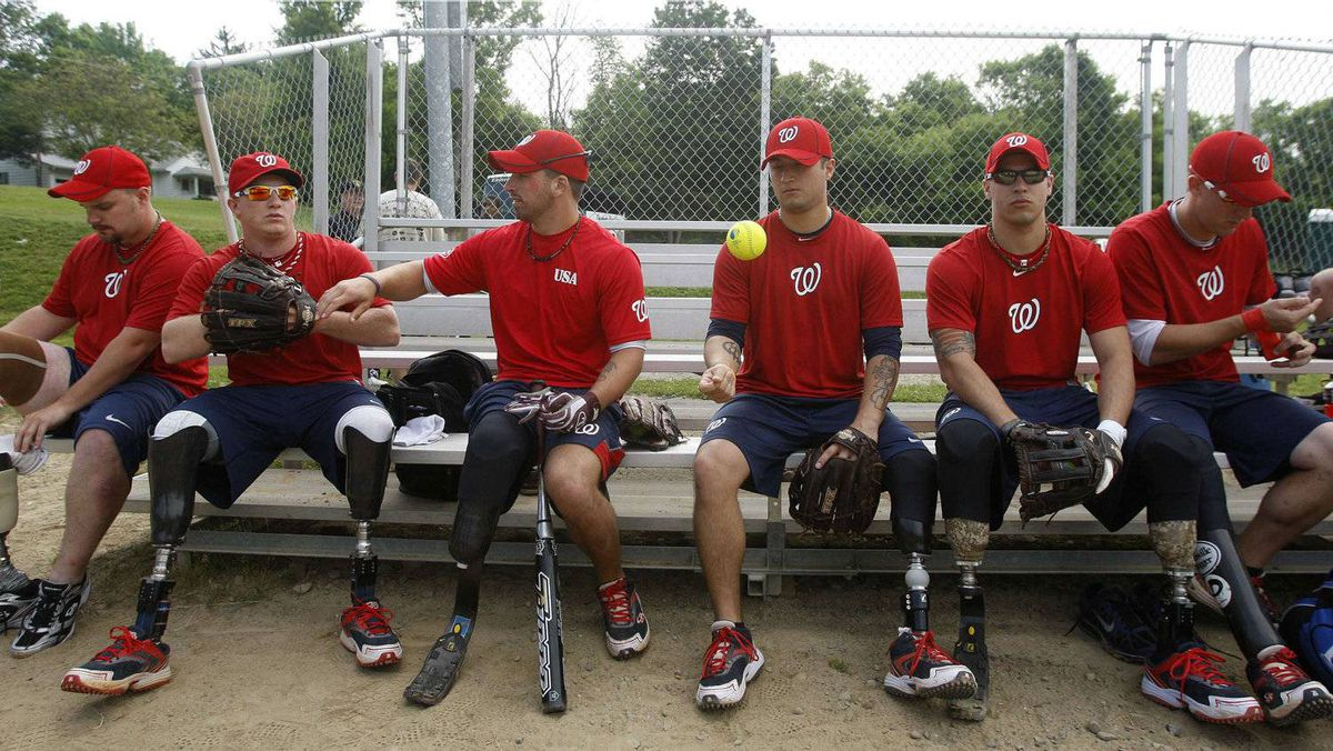 Members of the Wounded Warrior Amputee Softball Team prepare on their bench before the start of their practice in Binghamton, New York May 26, 2012, before their evening game against the Broome County New York law enforcement team. The team is a collection of United States military veterans who have lost limbs during their service in Iraq and Afghanistan, and tours the country playing competitive softball games against local teams. REUTERS/Gary Cameron