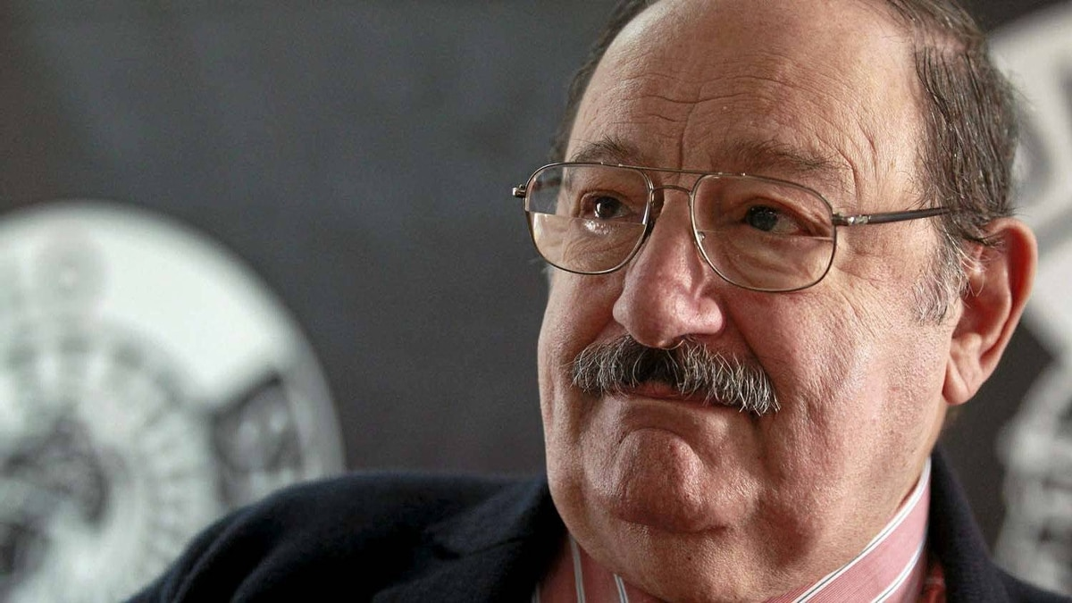 """Italian writer Umberto Eco listens to a question during the presentation of his latest novel """"The Prague Cemetery"""" in Madrid on Dec. 13, 2010."""