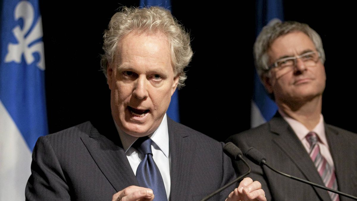 Quebec Premier Jean Charest, left, announces a commission of inquiry in the construction industry Wednesday, October 19, 2011 in Quebec City.