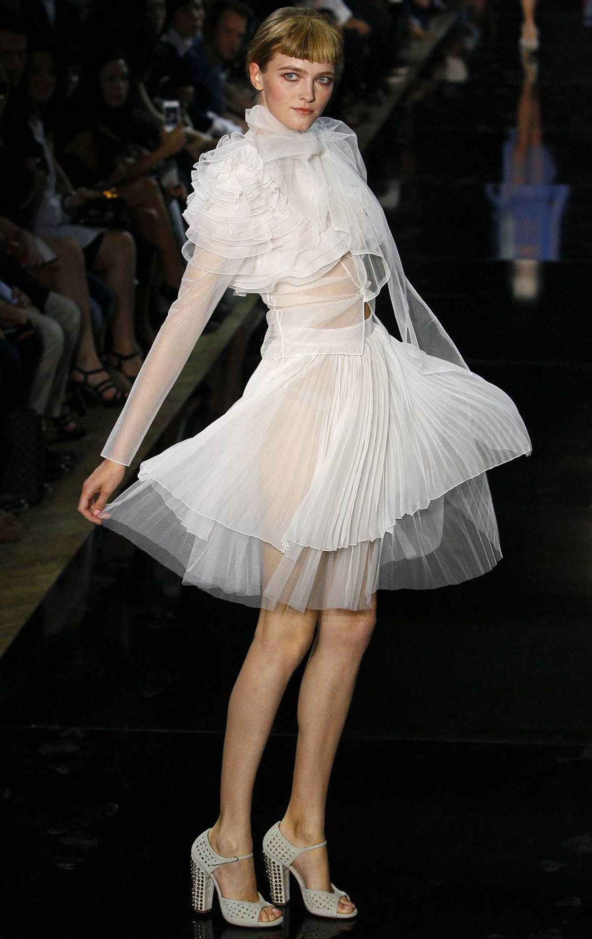 A model wears a creation by British fashion designer Bill Gaytten for John Galliano's spring-summer 2012 ready-to-wear collection presented Sunday, Oct.2, 2011 in Paris.