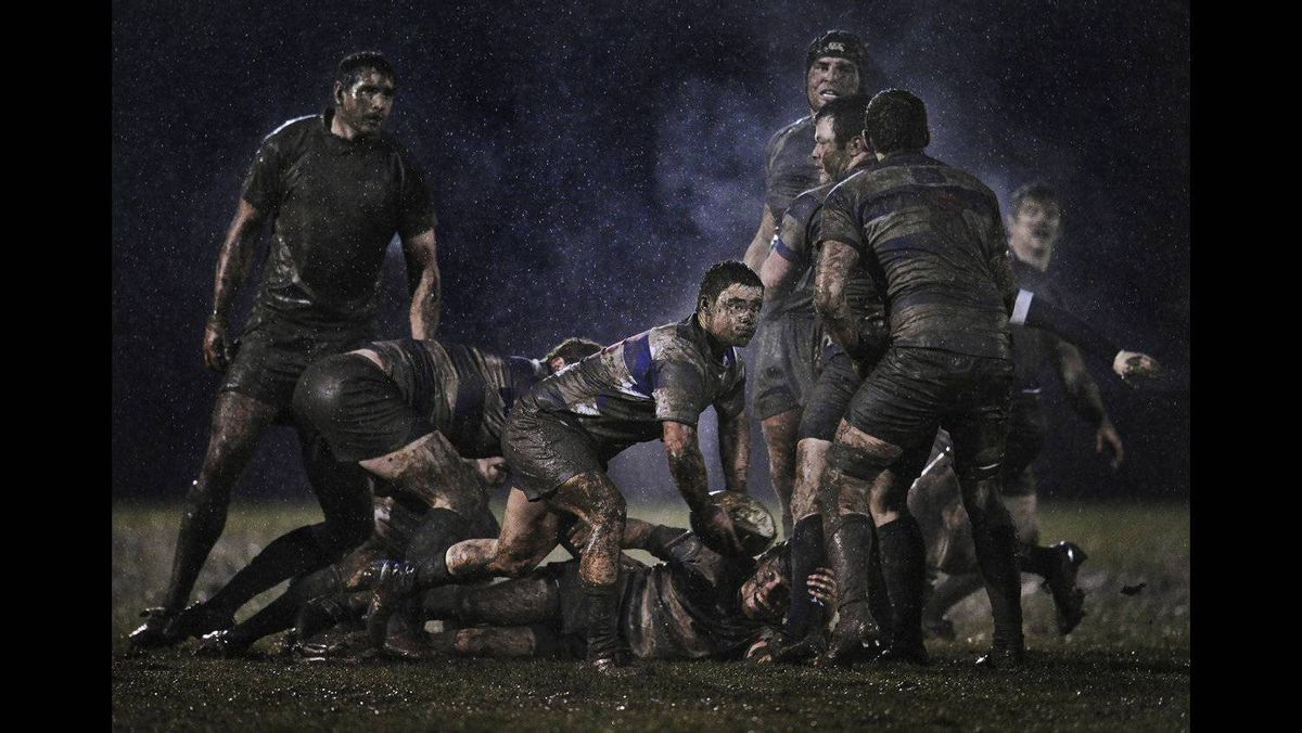 Ray McManus of Ireland, a photographer working for Sportsfile, has won the second prize Sports Singles with this action picture from a rugby match between Old Belvedere and Blackrock played in heavy rain in Dublin, Ireland.February 5, 2011.