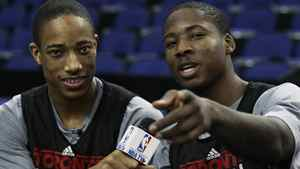 The Toronto Raptor's DeMar DeRozan and Ed Davis (R) interview each other before a basketball practice session ahead of their NBA game against the New Jersey Nets at the O2 Stadium in London March 3, 2011.