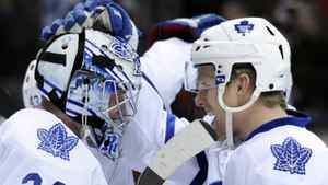 Toronto Maple Leafs right wing Joey Crabb (46) congratulates goaltender James Reimer (34) following an NHL hockey game against the Colorado Avalanche on Thursday, March 24, 2011, in Denver. Toronto beat Colorado 4-3. (AP Photo/Jack Dempsey)