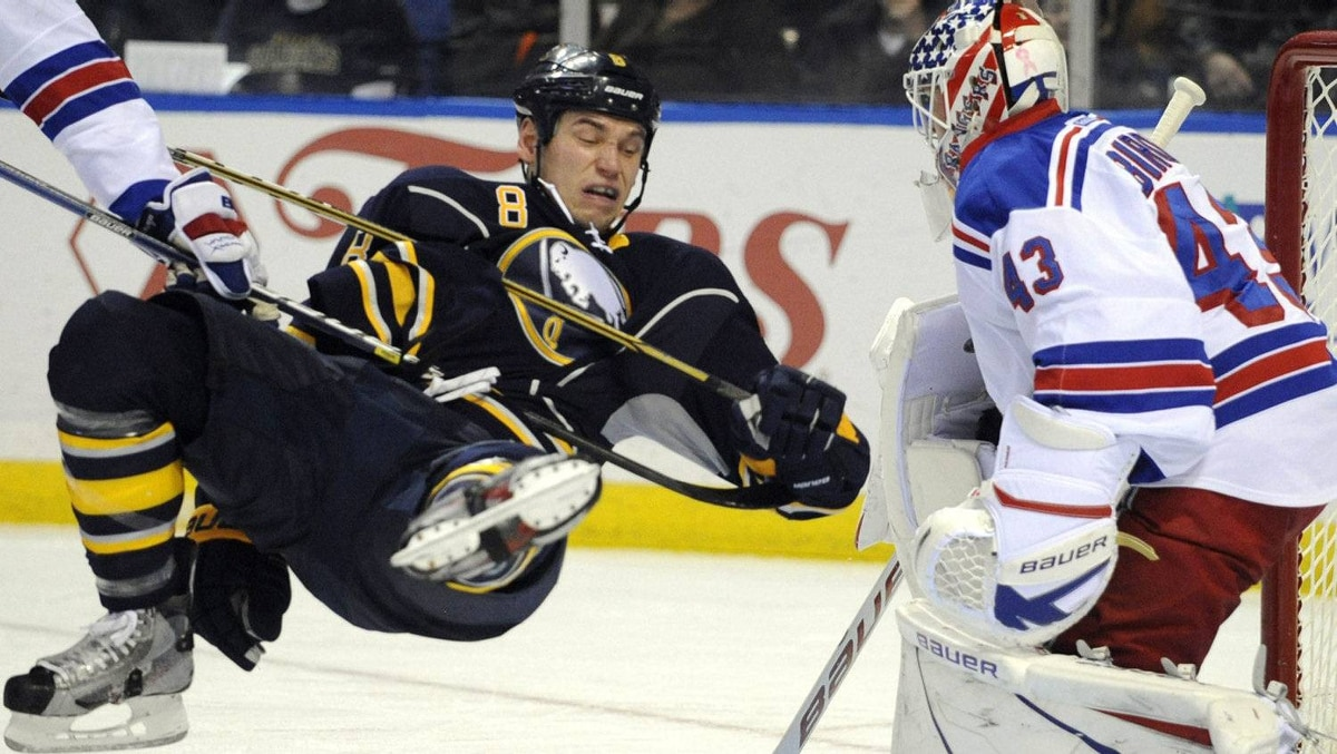 New York Rangers' Ryan McDonagh (left) trips Buffalo Sabres' Cody McCormick (8) in front of Rangers goalie Martin Biron (43) during the first period of an NHL hockey game in Buffalo, N.Y., Saturday, Dec. 10, 2011. The Rangers won 4-1. (AP Photo/Gary Wiepert)