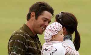 British Open winner Louis Oosthuizen is greeted by his wife and child on the 18th hole