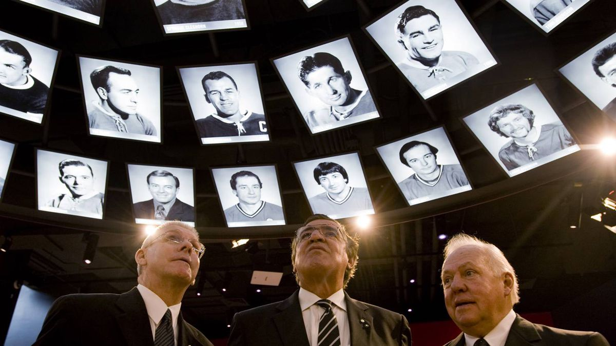 Former Montreal Canadiens' players (from left) Rejean Houle, Serge Savard and Yvan Cournoyer, take a look at photos of past players during a tour of the newly inaugurated Montreal Canadiens Hall of Fame in Montreal, Friday, Jan., 15, 2010. THE CANADIAN PRESS/Graham Hughes