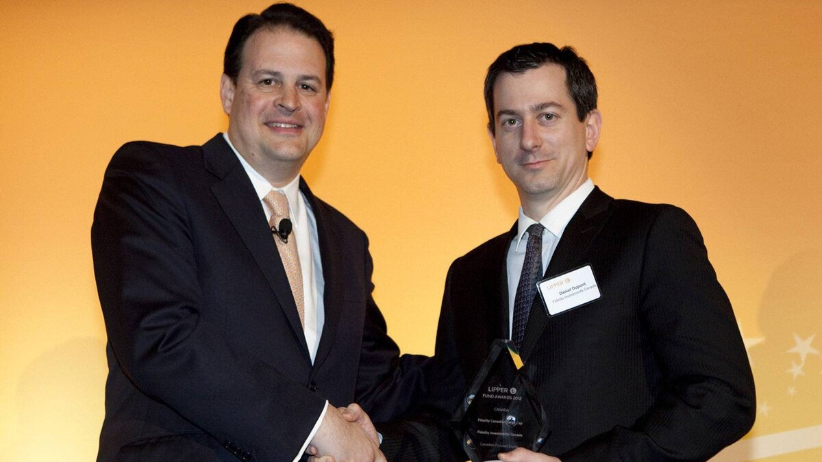 Jim Weber of Thomson Reuters, left, with Daniel Dupont, the recipient of two Lipper Awards.