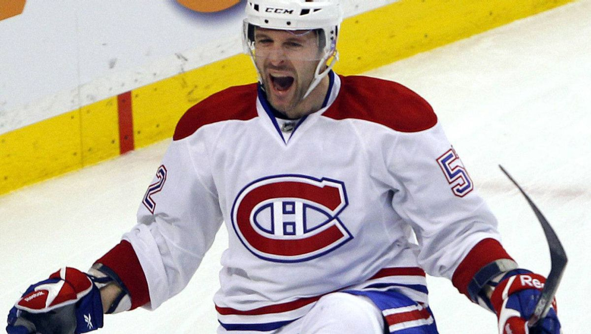 Montreal Canadiens left wing Mathieu Darche celebrates after scoring against the Boston Bruins during the first period in Game 2 of their NHL Eastern Conference quarter-final hockey game in Boston, Massachusetts April 16, 2011. REUTERS/Brian Snyder
