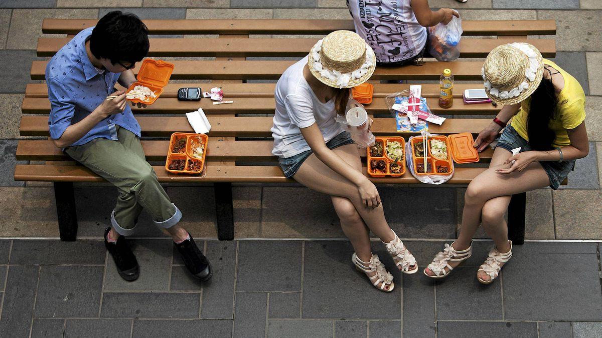 Chinese people eat lunch on a bench outside a shopping mall in Beijing, Wednesday, June 15, 2011. China's inflation rose to its highest level in nearly three years in May, thanks largely to stubbornly high food prices, adding to economic and social strains that have fanned recent protests.