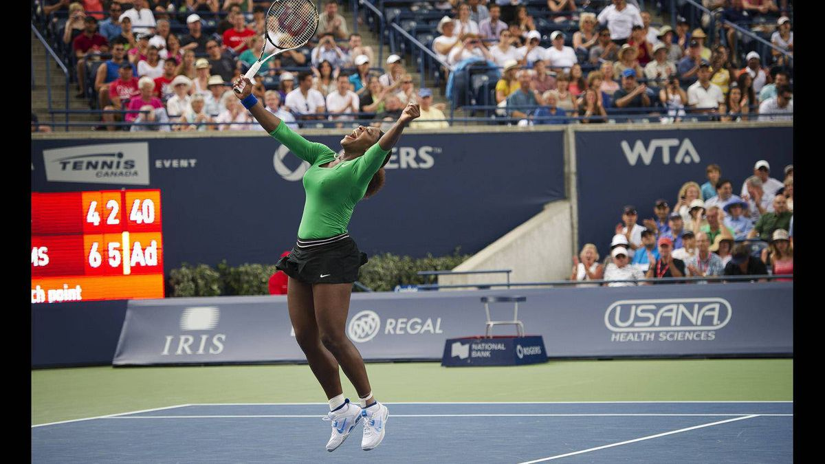 Physically impressive and intensely competitive, Serena Williams is a photographer's dream. While covering the 2011 Rogers Cup in Toronto last August I had the opportunity to photograph her as she captured her second WTA win since coming back from injury. Whether screaming in disgust or pumping her fists in celebration every move the brash tennis star made seemed to be a potential front-page photo. So when Williams' advanced to the Rogers Cup Final against Australian Samantha Stosur, every photographer at Rexall Centre was thrilled. As the match went on it became apparent that Williams was directing her fits of demonstrative jubilation toward a particular corner of the stadium where Canadian recording artist Drake was sitting courtside. Leading up to the tournament there had been rumours that Serena and Drake were romantically involved. Whether the rumours were true or not it was obvious that each time Williams won a point she would turn and pump her fists directly toward the hip-hop star. Naturally, by the end of the match, many of us had recognized this and positioned ourselves on the 'Drake side' of the court. When Williams finally fired a blistering ace past Stosur taking the match 6-4, 6-2 she jumped high in the air, turned toward Drake (and our lenses) and, as anticipated, pumped her fist in celebration.