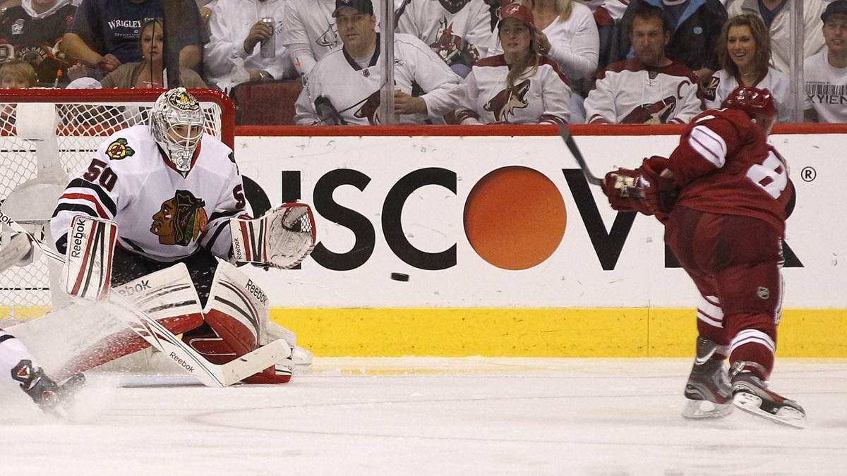 Phoenix Coyotes' Gilbert Brule (8) sends a shot past Chicago Blackhawks' Corey Crawford (50) for a goal during the second period in Game 5 of an NHL hockey Stanley Cup first-round playoff series Saturday, April 21, 2012, in Glendale, Ariz.