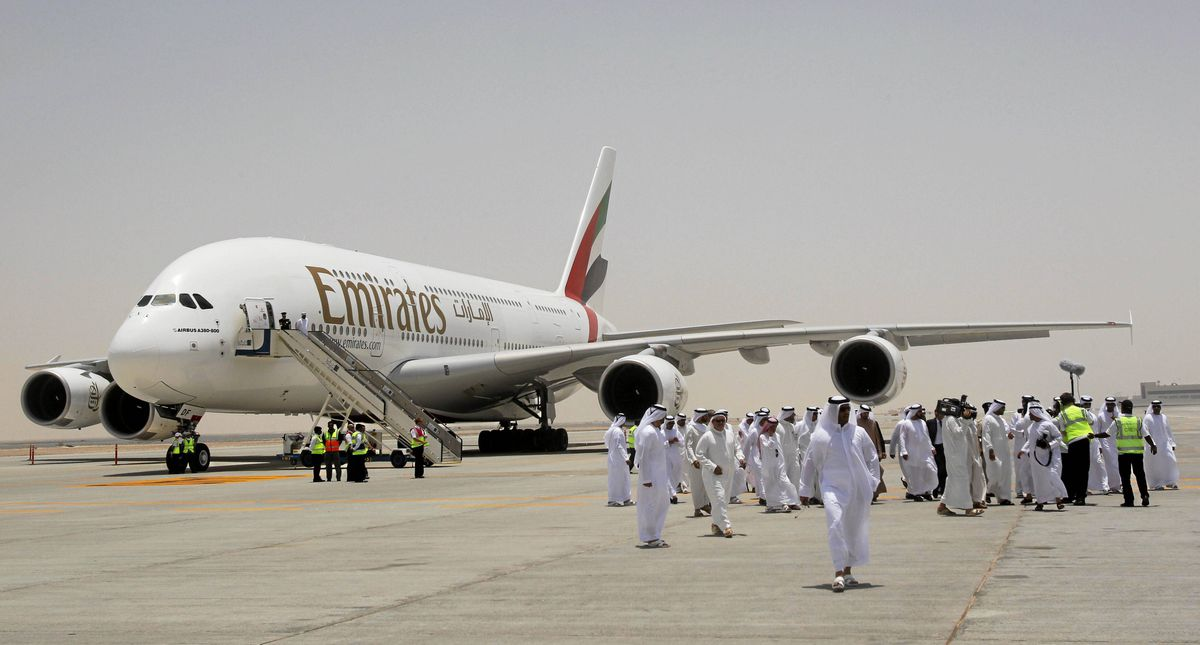 An Emirates Airlines plane is parked at Dubai World Central airport