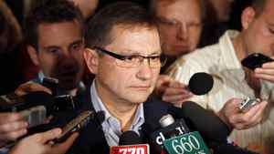 Alberta Premier Ed Stelmach takes questions during a scrum at the Alberta PC party's annual meeting in Red Deer.