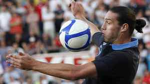 England's Andy Carroll controls the ball during their international friendly soccer match against Norway at the Ullevaal Stadium in Oslo, May 26, 2012. England won 1-0. REUTERS/Darren Staples