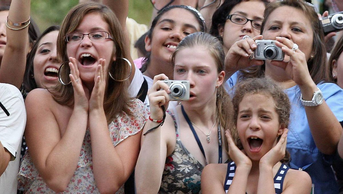 Royal fans try to catch a glimpse of Prince William, Duke of Cambridge and Catherine, Duchess of Cambridge as they visit Sainte-Justine University Hospital on July 2, 2011 in Montreal, Canada.