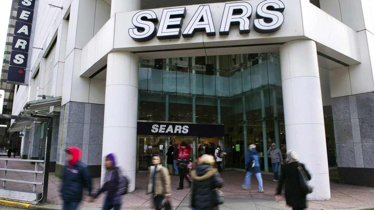 People walk past the main Sears store in downtown Vancouver, British Columbia on February 23, 2011.