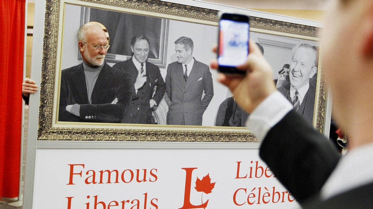 Liberal Party member Raymond Trafford, from Elora, has a souvenir photo taken by John Stadelmayer, right, at the Liberal Convention in Ottawa.