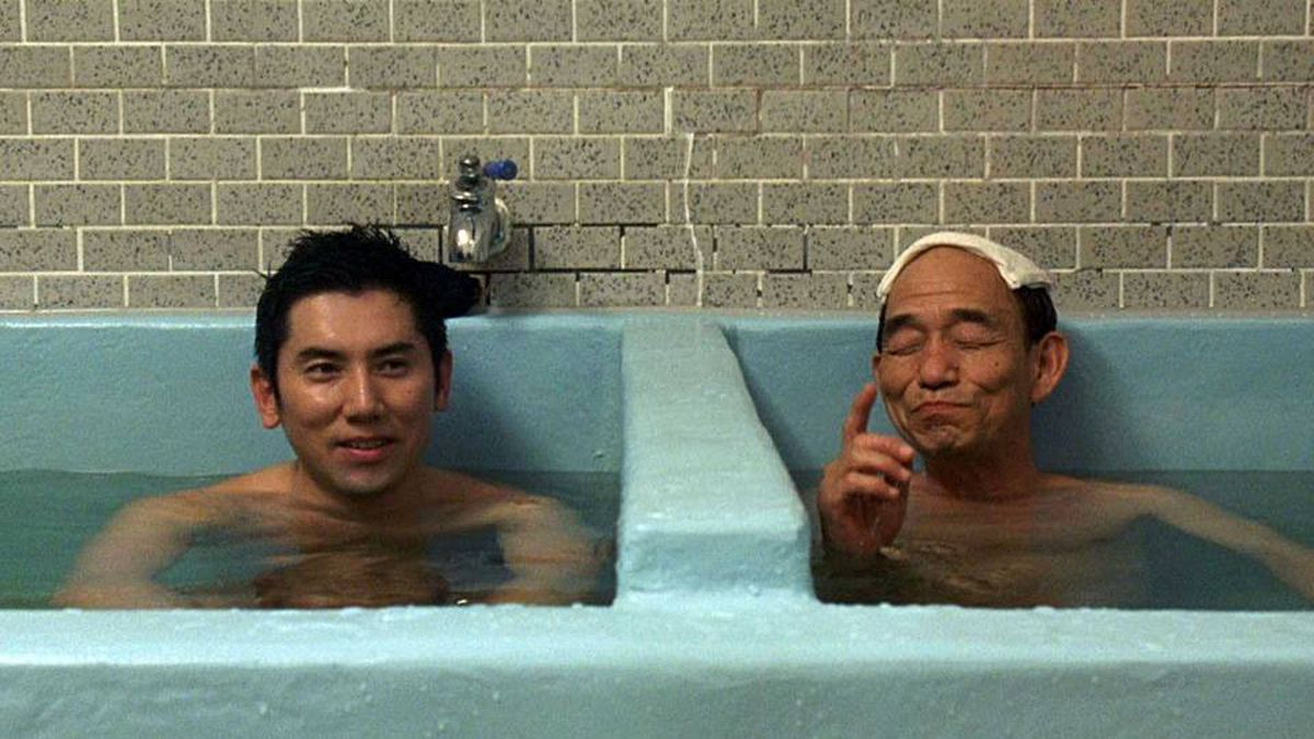 Masahiro Motoki (left) plays an out-of-work musician who enjoys his new job as a mortician. The film, however, breaks no new ground.