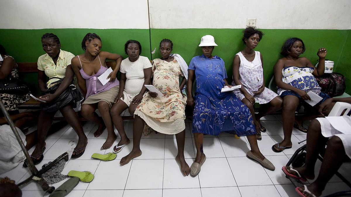 Pregnant women who are in labour wait for a bed to open up to deliver their babies at Isaie Jeanty Maternity Hospital run by Medecins sans Frontieres in Port-au-Prince, Haiti.