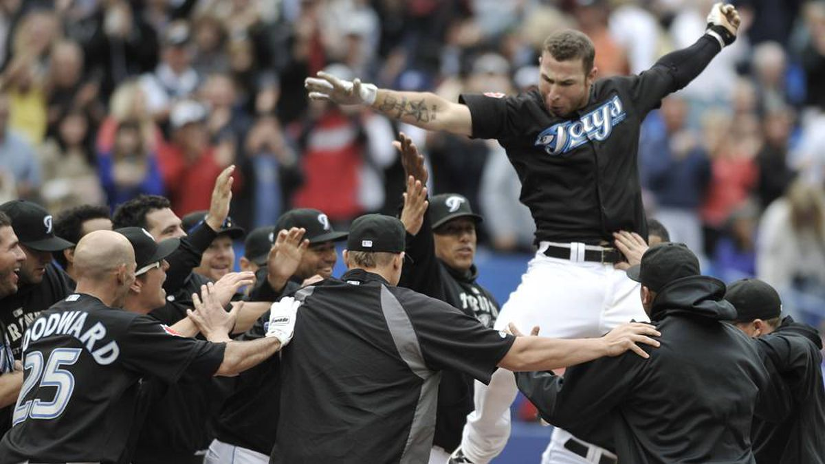 Brett Lawrie of the Toronto Blue Jays celebrates his home run with teammates.