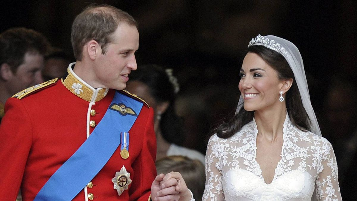 William and Kate, Duke and Duchess of Cambridge, share a smile outside of Westminster Abbey after their wedding ceremony.