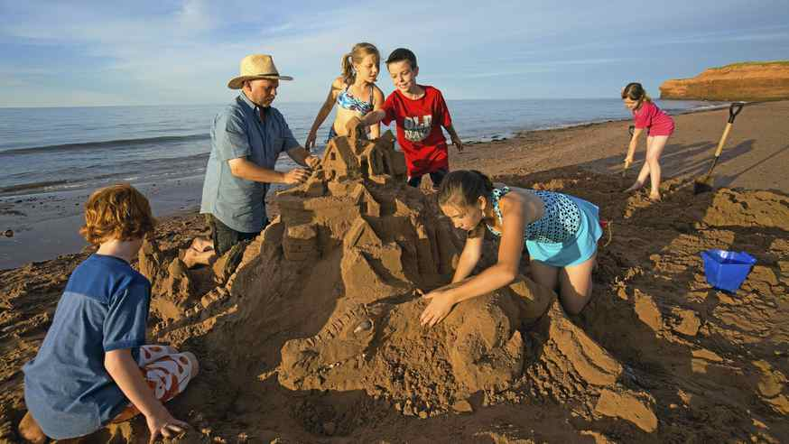 Local artist Maruice Bernard helps park visitors create outstanding sandcastles on PEI's red beaches.